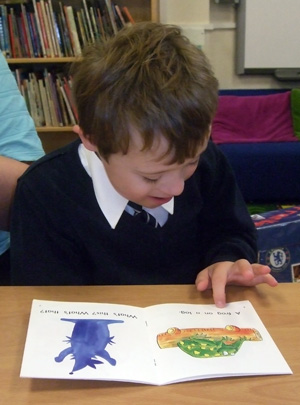 Photograph of a boy reading