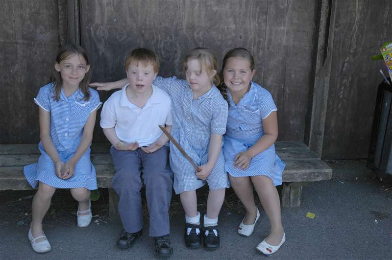 A photograph of school children, including children with Down syndrome