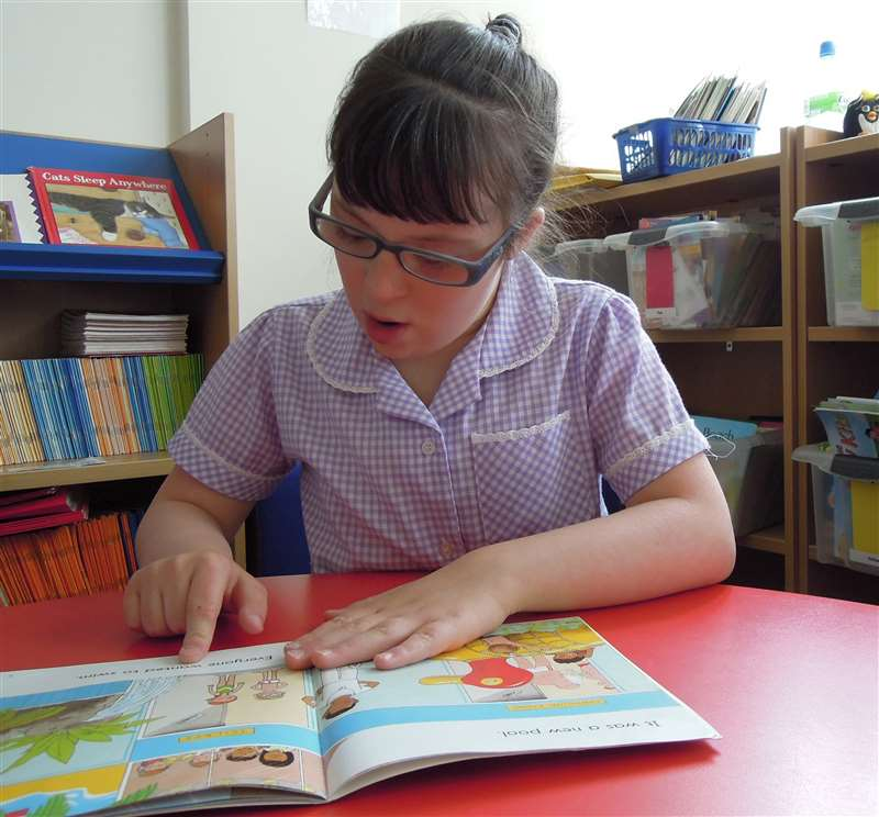 A girl with Down syndrome learning to count with a number line