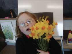 Ynez holding a bunch of daffodils