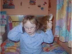Ynez brushing her hair